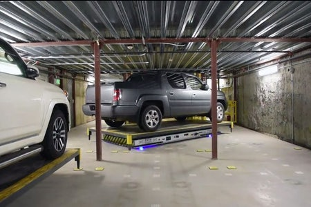 Automated Guided Vehicle (AGV) parking vault
